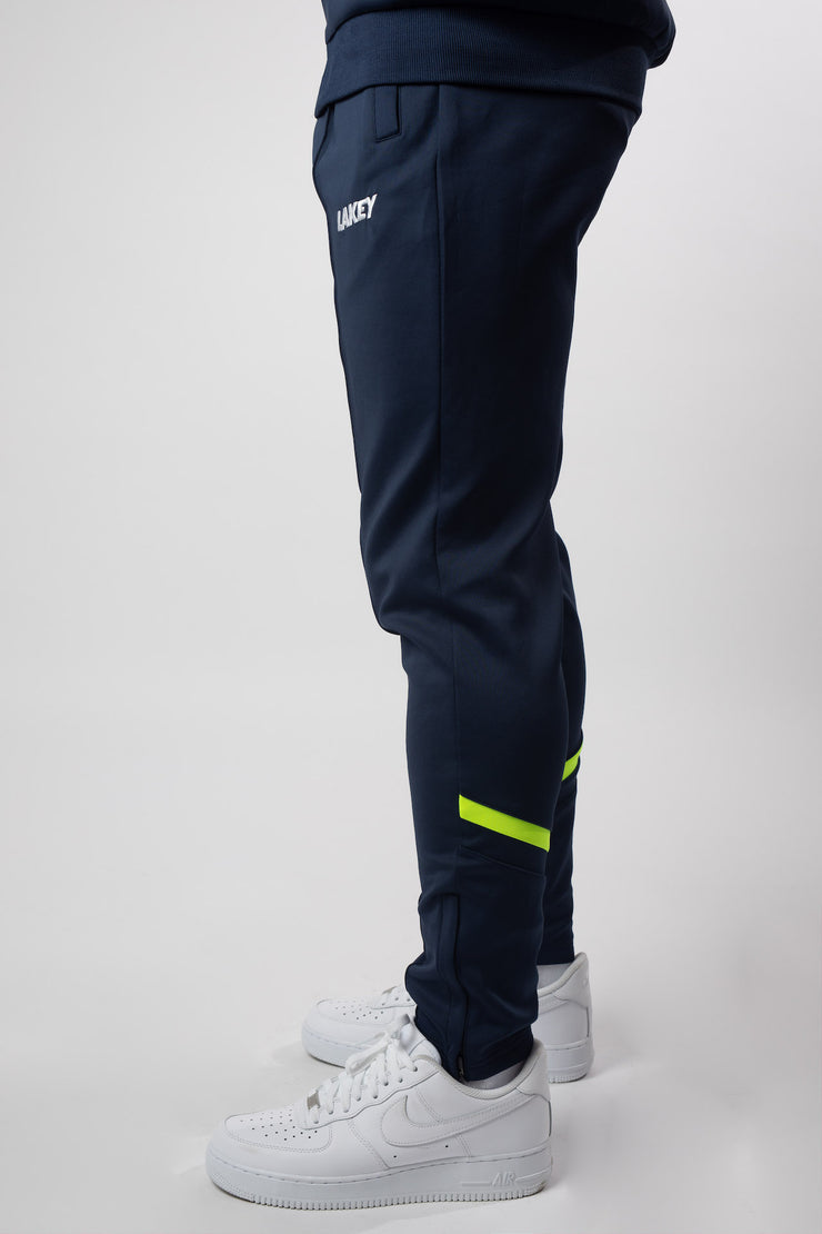 CHEVRON PLUS TRACKPANTS NAVY/NEON YELLOW