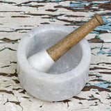 Mortar and Pestle perfect for grinding herbs and spices in marble and wood
