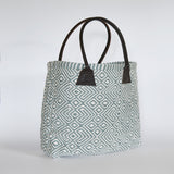 This beautiful, soft, handwoven bag is made using yarn spun entirely from recycled plastic bottles