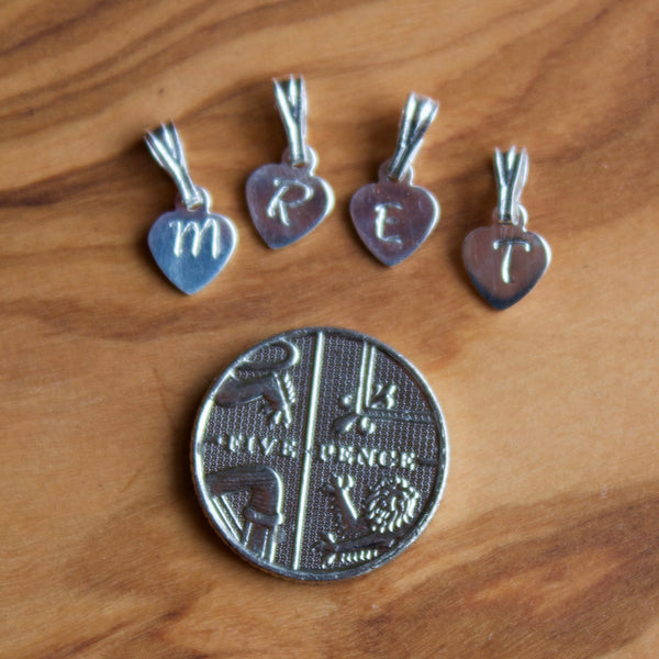 hand stamped letter charms