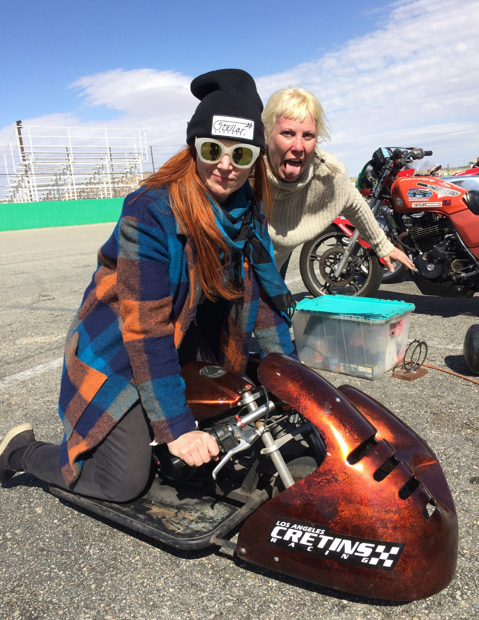 Two friends having fun at the race track