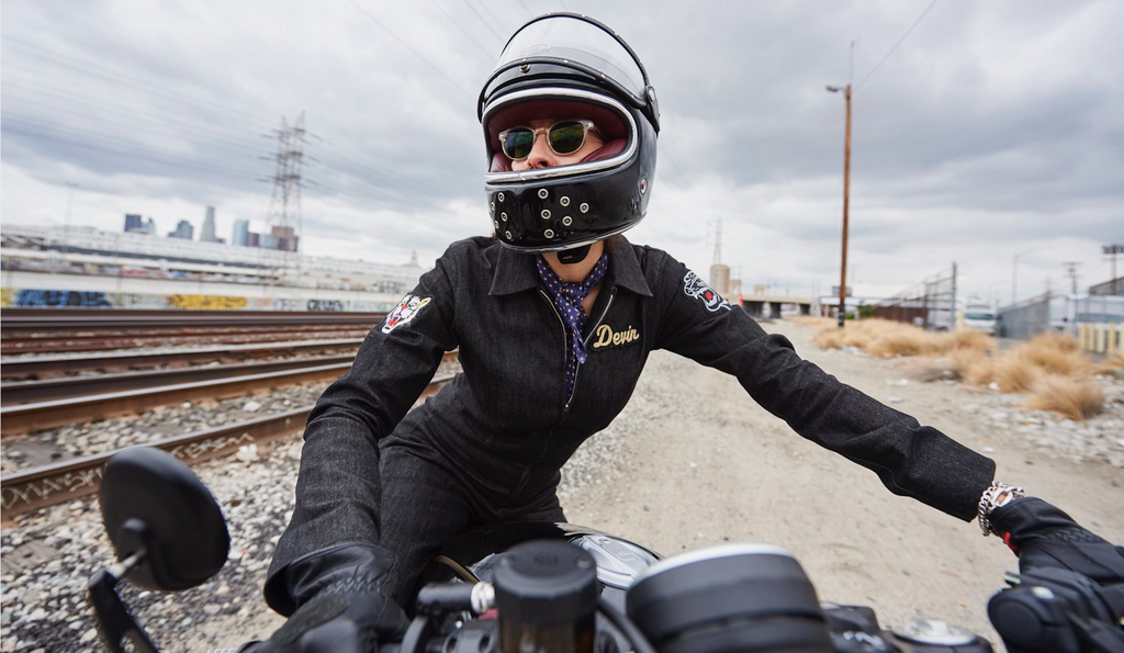 Woman on a Ducati Scrambler wearing our Stratosphere Dyneema jumpsuit with customized patches