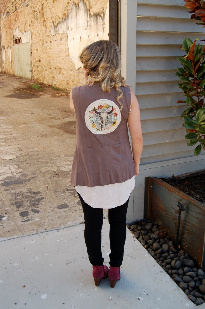 Boho Jane suede vest with bull skull and speak no evil script.  Bohemian style suede vest.  Fair trade compliant clothing.