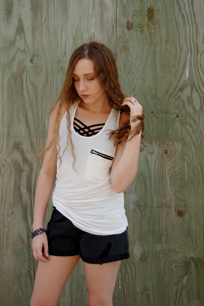 POL white racerback summer tank with black front and rear zipper detail.