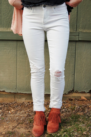 White skinny jean with frayed hem and distressed holes at knee.  The best fitting, Articles of Society brand jean.  Not sheer!