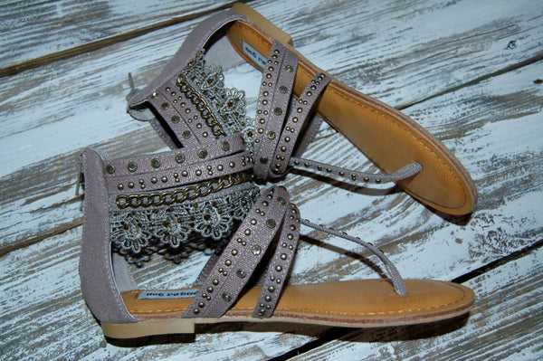 Not Rated Wilma sandal features strappy sandal look with stud, rhinestone and lace detail.
