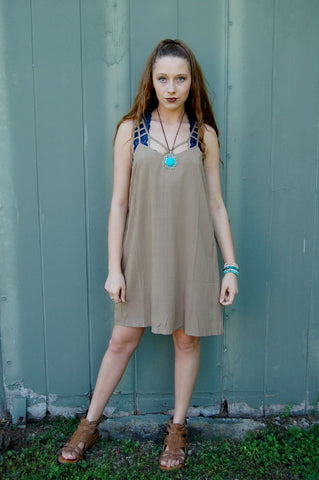 Neutral dress with cutout detail along straps.  Summer shift dress. Fully lined.