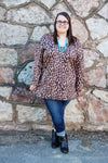 Leopard print keyhole back plus size top.