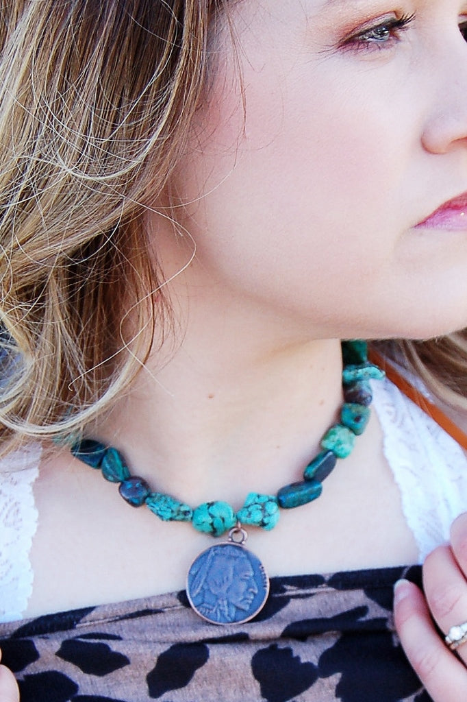 Jewelry junkie indian head african turquoise collar length necklace.