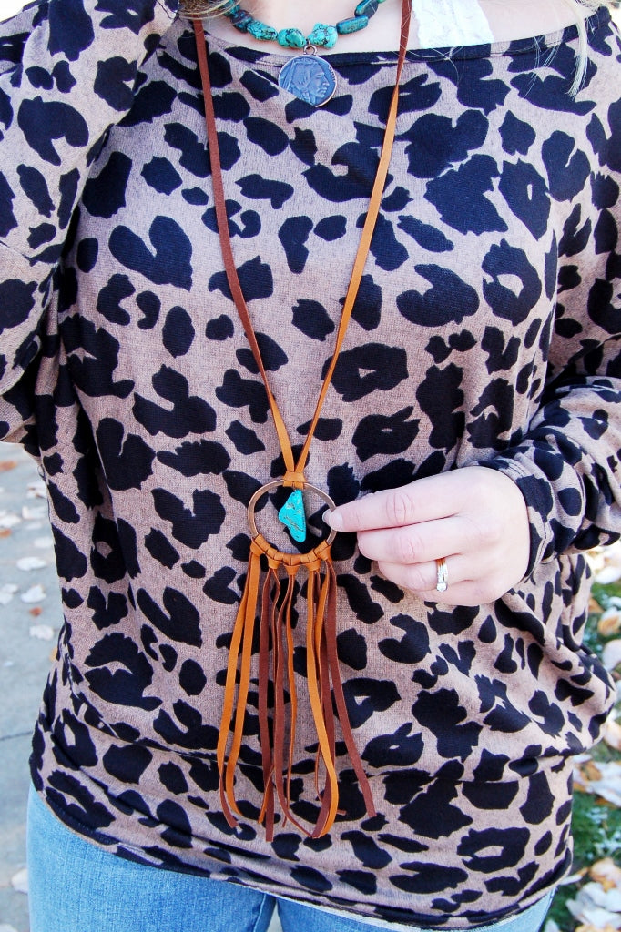 Jewelry Junkie leather dreamcatcher necklace with turquoise chunk.