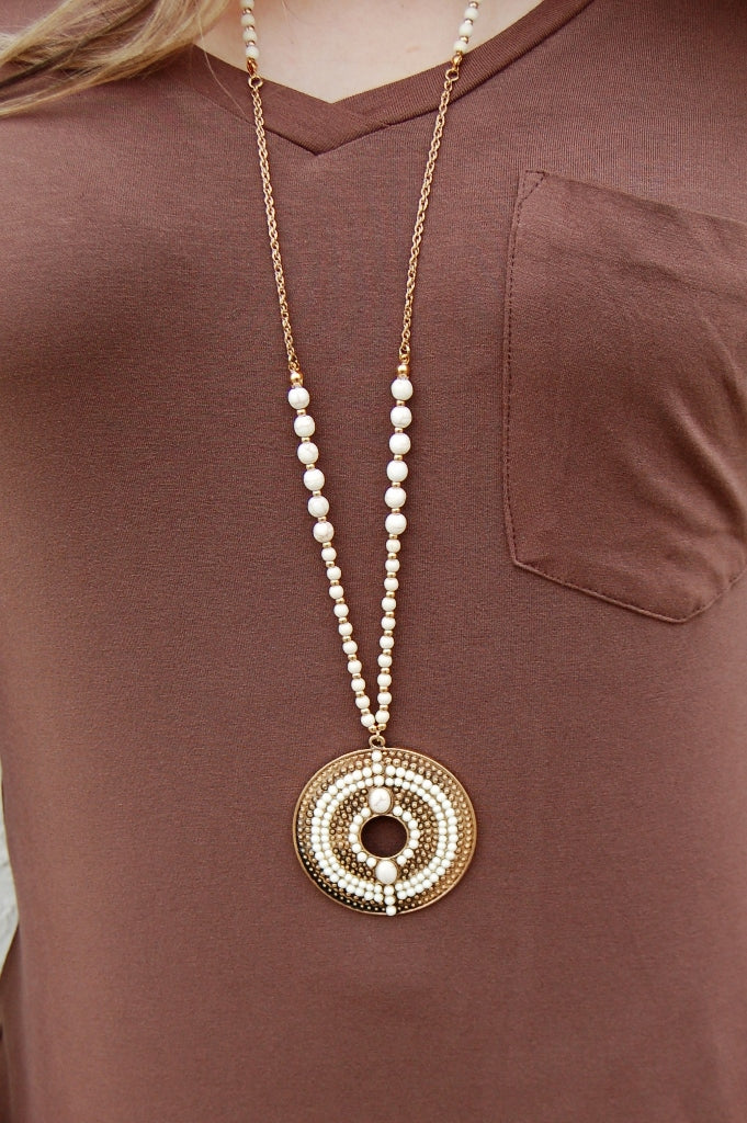 Howlite white round bohemian style pendant necklace and earring set.