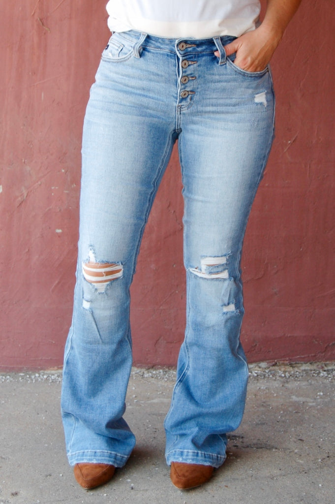KanCan medium wash mid rise flare jeans with button fly.  button fly flare denim.