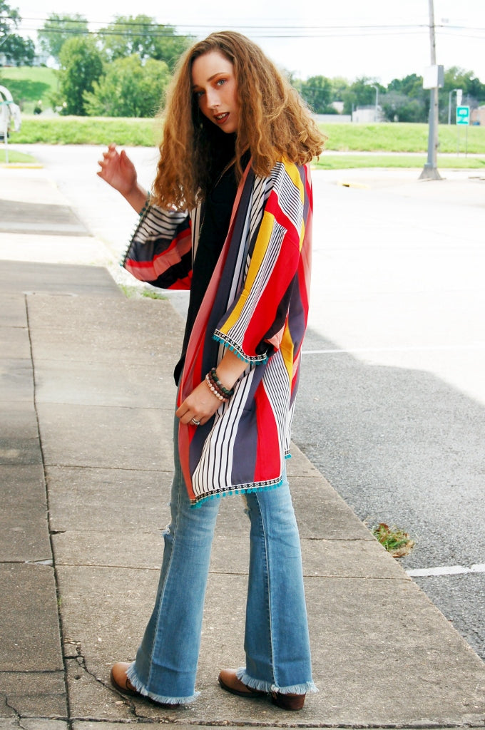 Bohemian vintage inspired vertical stripe kimono cardigan with fringe trim. Open front striped kimono.  Main Strip.