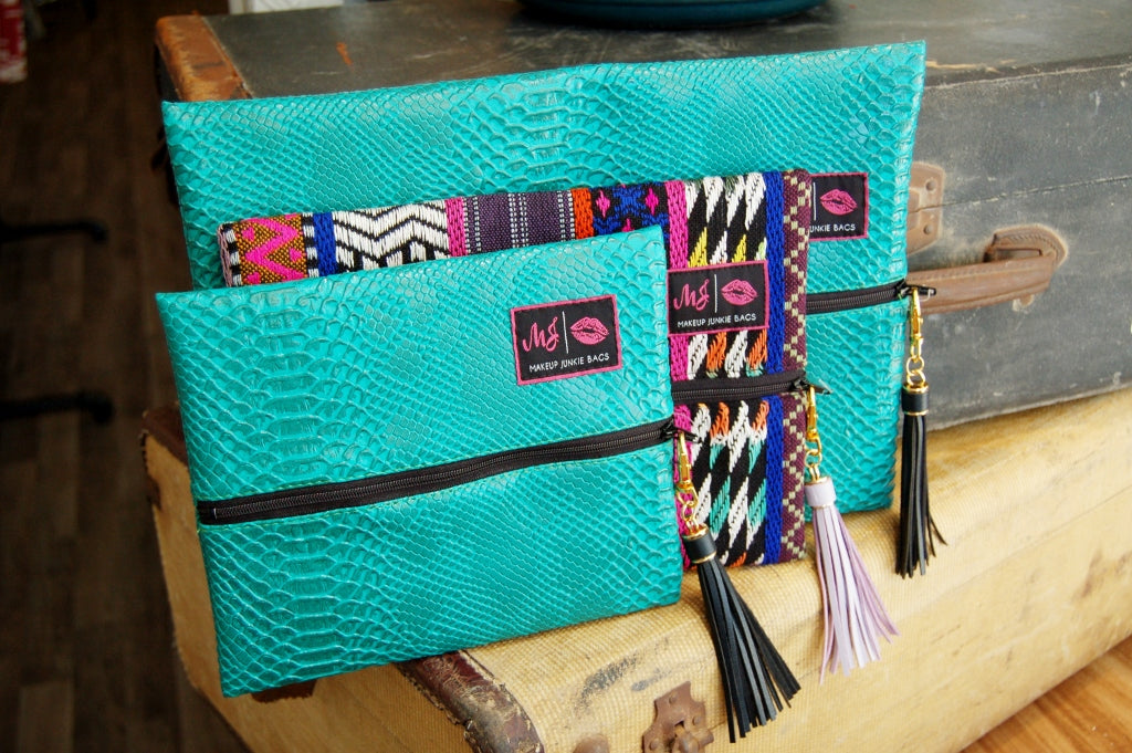 Turquoise cobra make up junkie large bag.