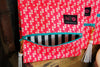 Coral crush with glam stripe lining make up junkie bag.  Teal zipper coral crush.