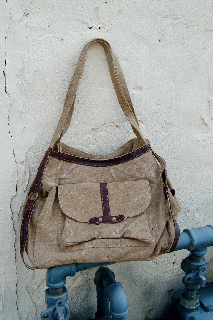 Mona B live love wander tote bag with leather handles.  Upcycled, eco friendly military truck tarp handbag.