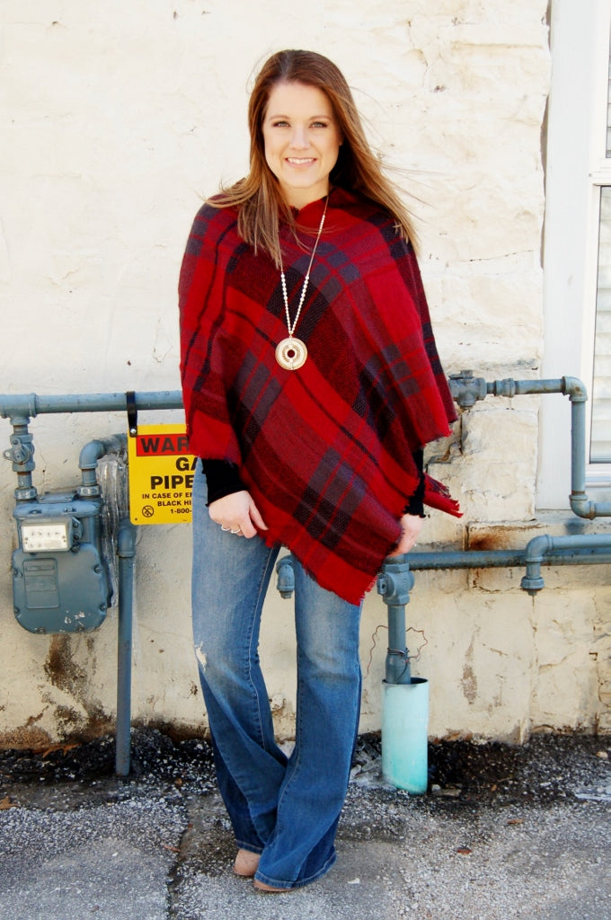 Red and black plaid pull over poncho.  Cheeky's one size fits most poncho.