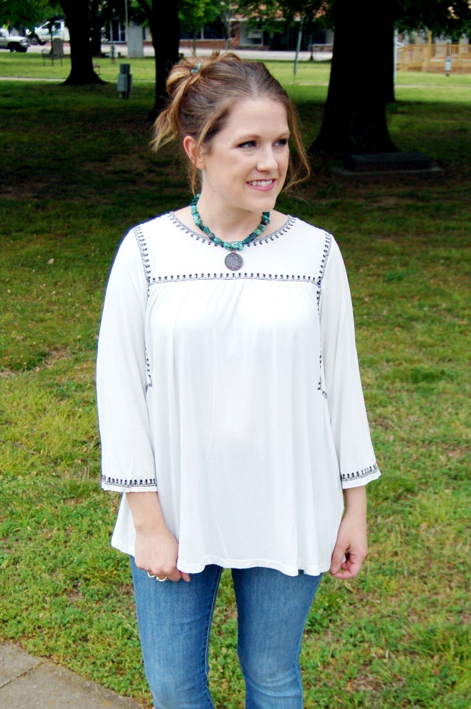 POL peasant top.  Flowy white top.  White top black embroidery.  Bohemian style top.  Button back detail.  Black tie affair top.