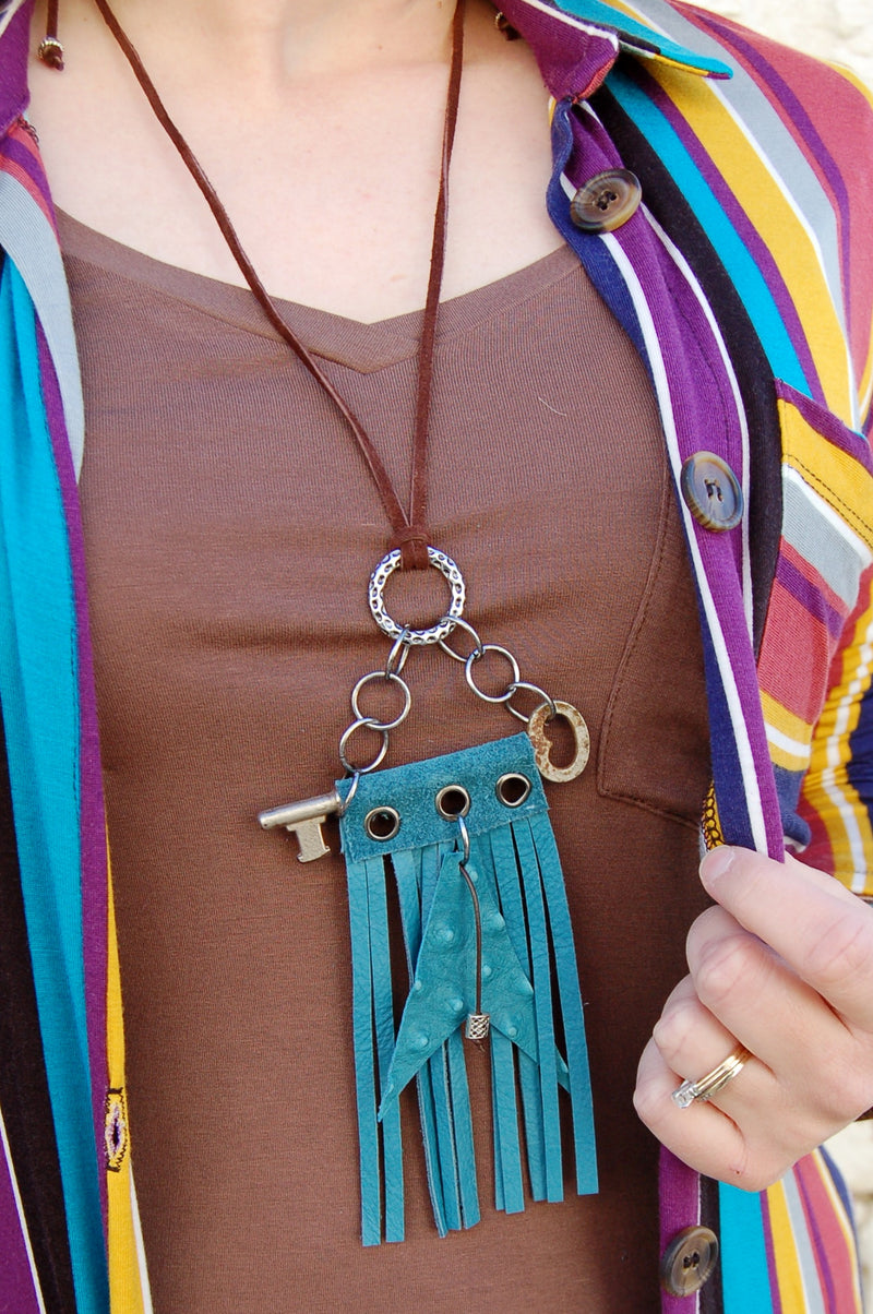 One of a kind turquoise ostrich leather necklace.  Bohemian western style necklace with fringe and skeleton key.