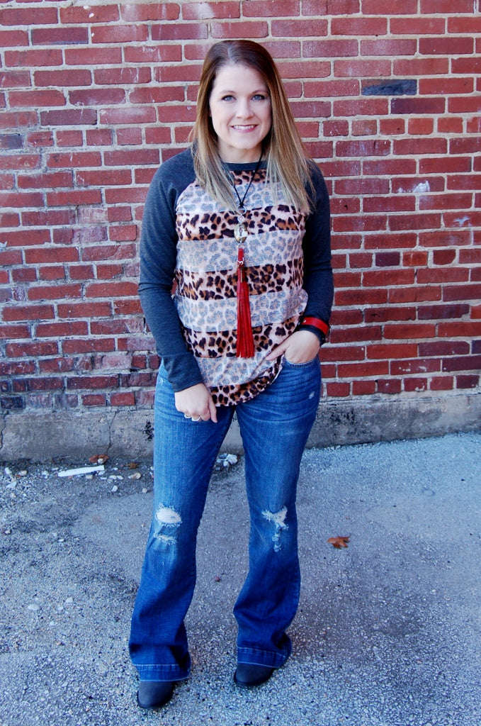 Cheetah print leopard print elbow patch long sleeve top.