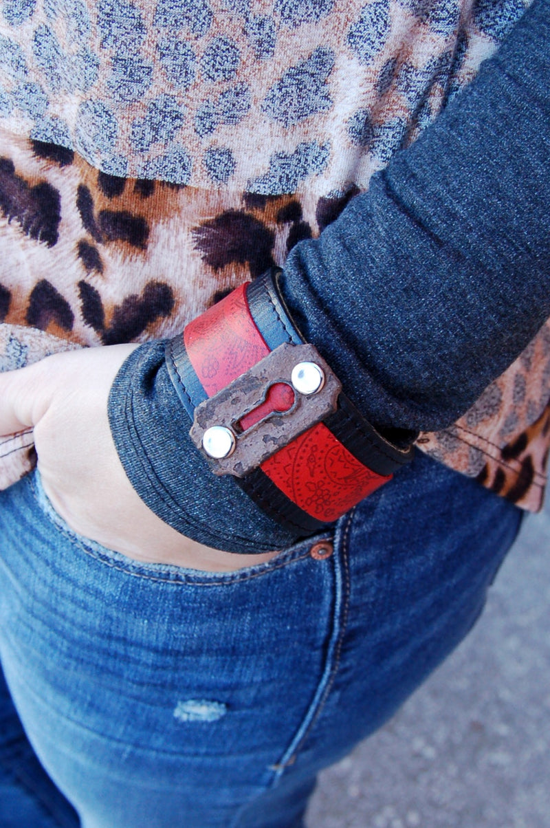 Red and black leather cuff with vintage keyhole detail.  Handmade bohemian western style leather cuff bracelet.