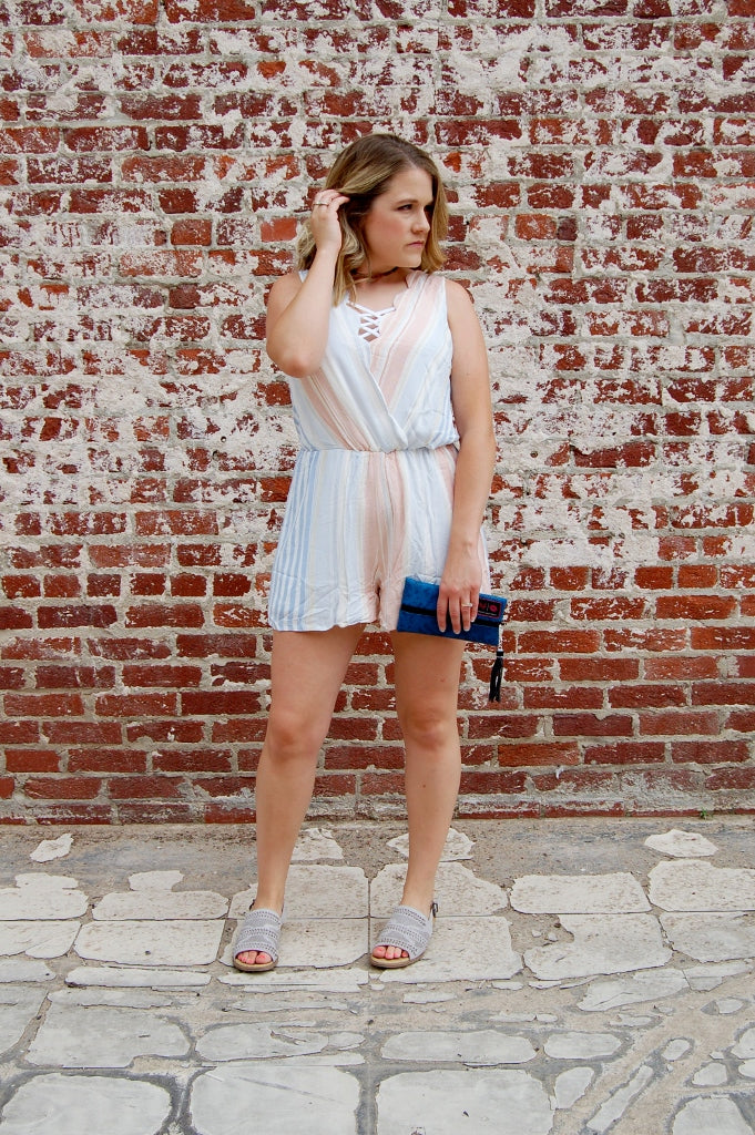 Pastel vertical stripe summer romper with scalloped edges.  Feminine, flirty and flattering bohemian style romper by entro.