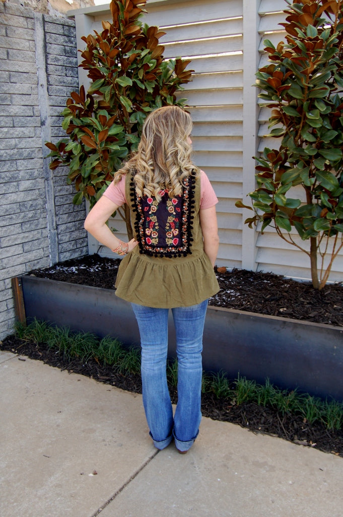 Faux suede vest with preplum ruffle and intricate embroidery.  Entro outerwear.