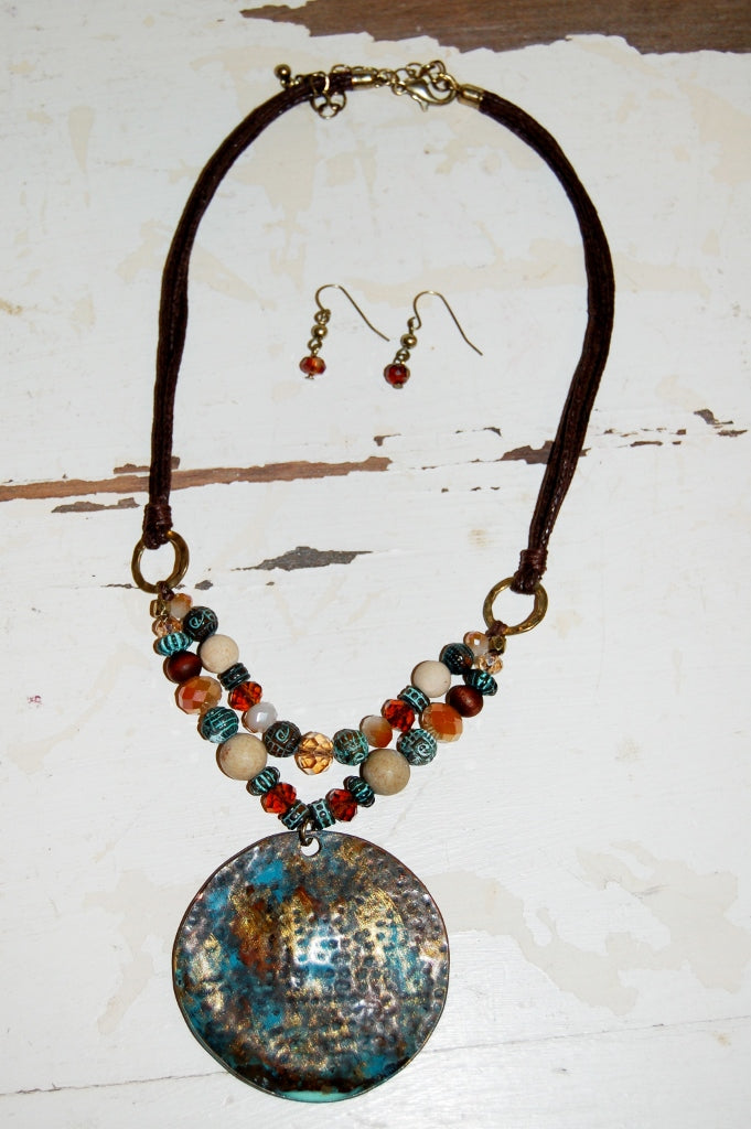 Round patina pendant necklace.  Bohemian western style jewelry.
