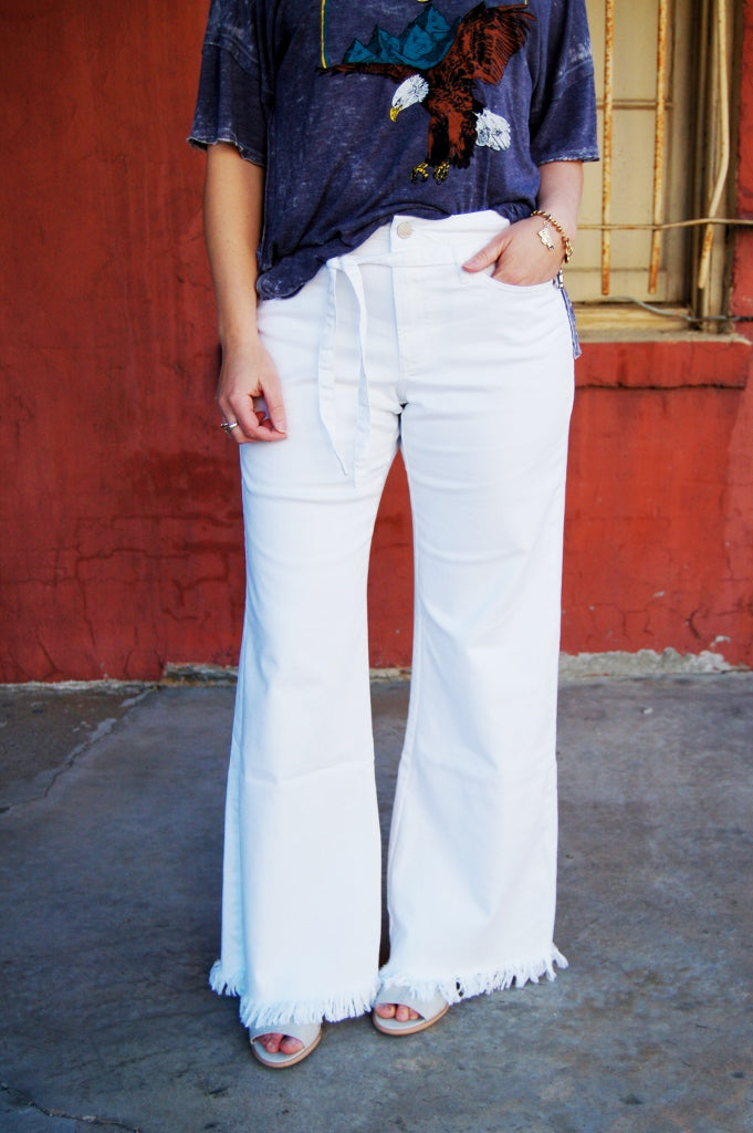Mila highrise wide leg pants by dear john.  white jeans for summer.  White trouser pants.  Belted white pants.