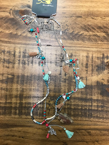 Bohemian style necklace with double layers of beadwork, arrowhead charms and tassel charms.  Kurtmen designs boho necklace.