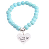 "Image of ""You Had Me at Woof"" Charm Bracelet Paw Print Jewelry"