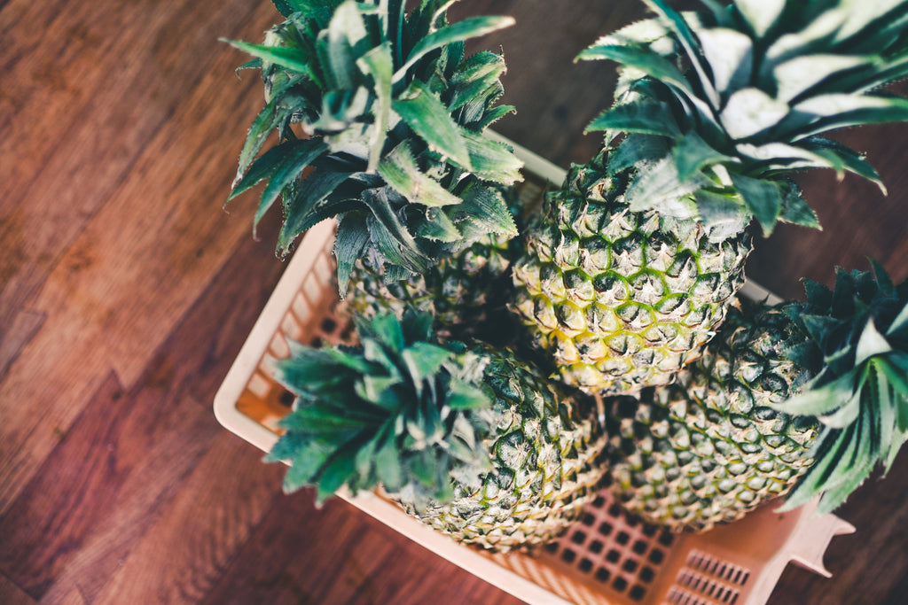 Pineapples in a basket, photo by Kotagauni Srinivas