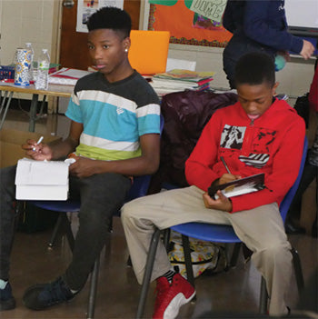 Teen boys in classroom at our mentorship program