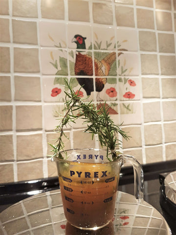Fresh Rosemary steeping in Broth for Brain Healthy Rosemary Chicken Broth Popsicle for Dogs and Wellness.