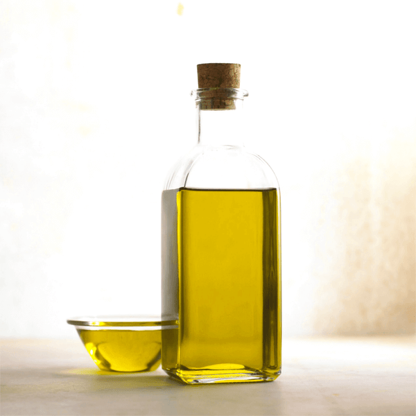 Photo of a Bottle of Olive Oil for Article About the Health Benefits of Eating Extra Virgin Olive Oil for Dogs and People