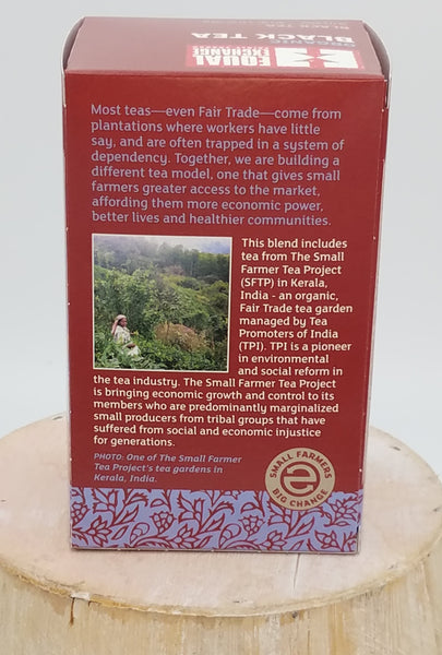 Back of the tea box photo shows a photo of the tea farm and harvester, and describes the fair trade practiced by Equal Exchange, this brand of tea, through their Small Farmer Tea Project.