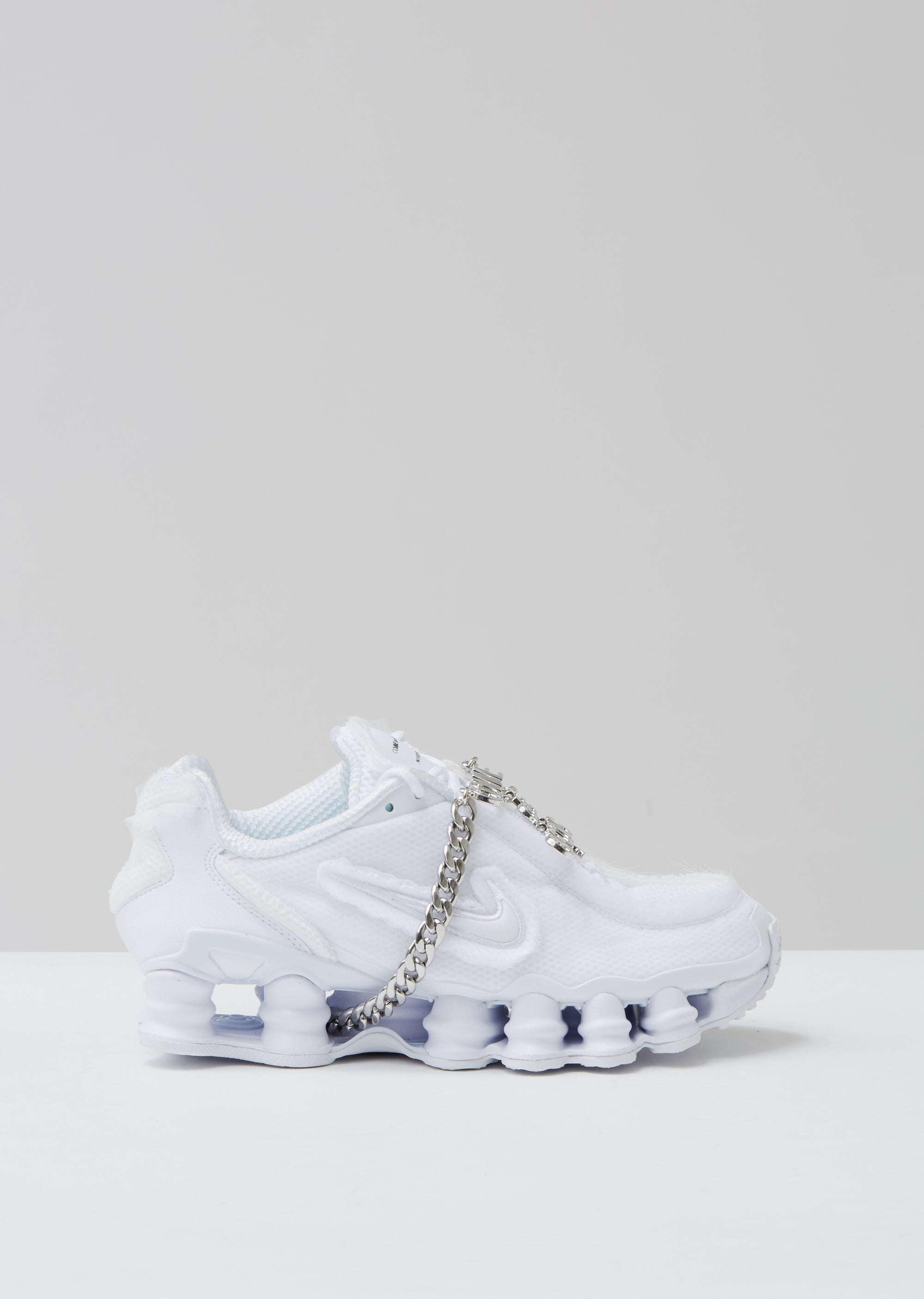 competitive price 82000 8140f CDG x Nike Shox TL