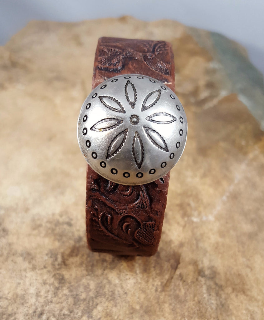 Tooled cuff bracelet with domed flower concho