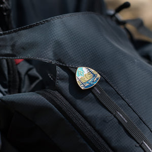 Appalachian Trail enamel pin on bag