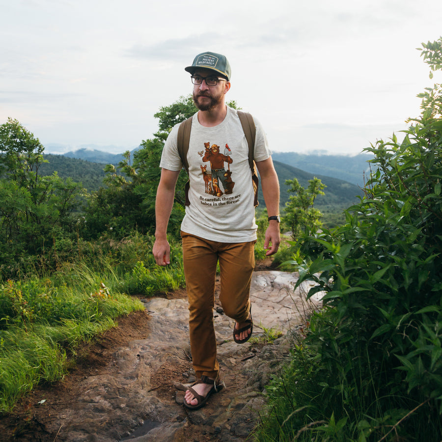 man hiking in t-shirt