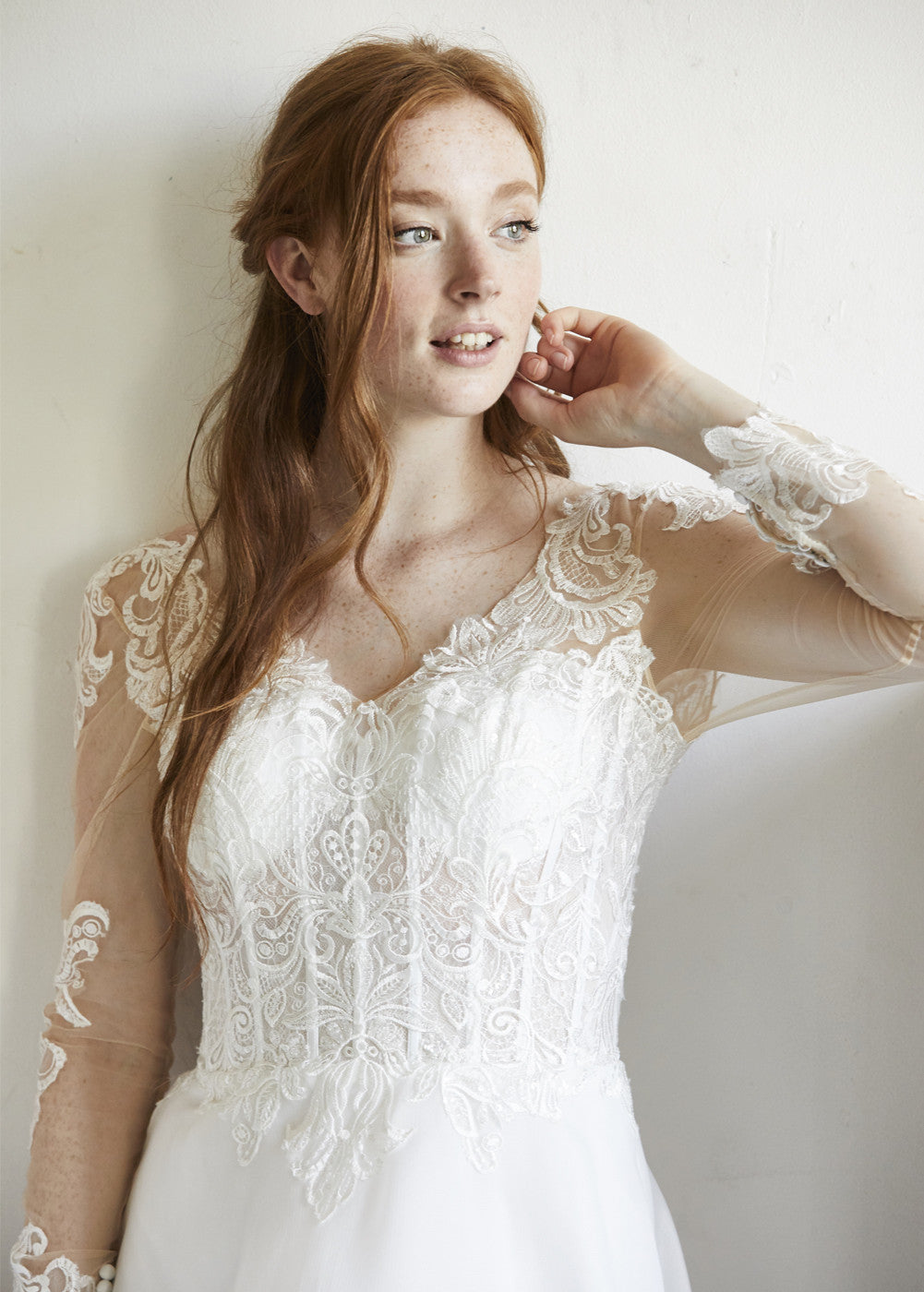 Long Sleeve Sheath Wedding Gown With A See Through Corset