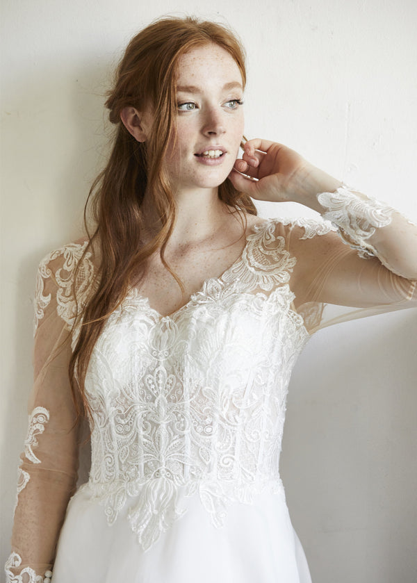 Long Sleeve Sheath Wedding Gown With a See-through Corset