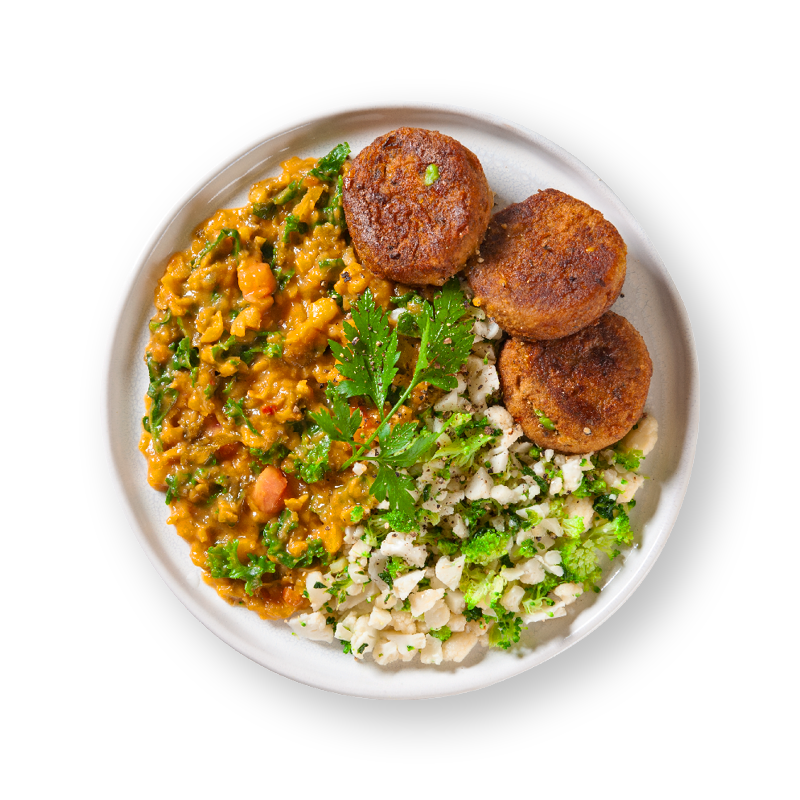 Organic Vegetable Fritters with Kale Dahl & Broccoli and Cauliflower Rice
