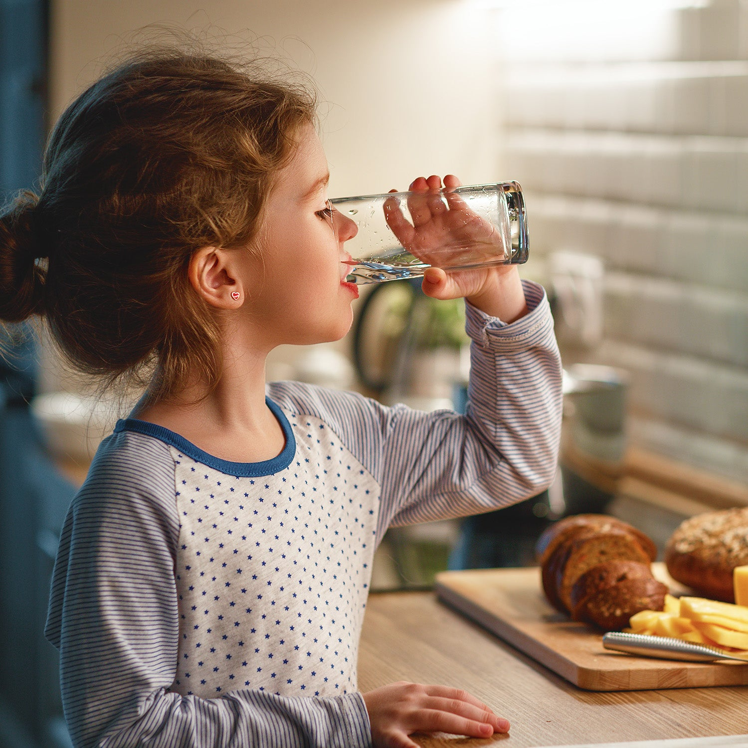image of young boy drinking water from the seagull 4 water filter