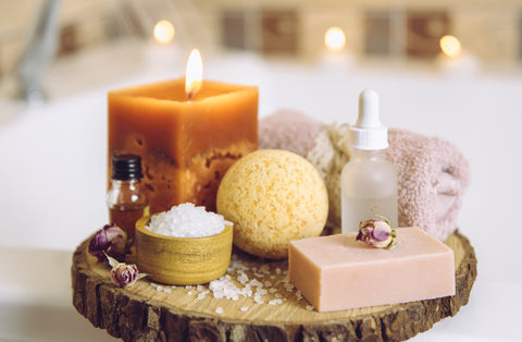variety of at home spa products beside the bathtub