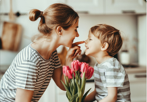 Son giving his mom flowers.