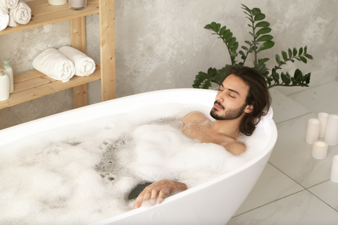Man relaxing in a bathtub with a bubble bath