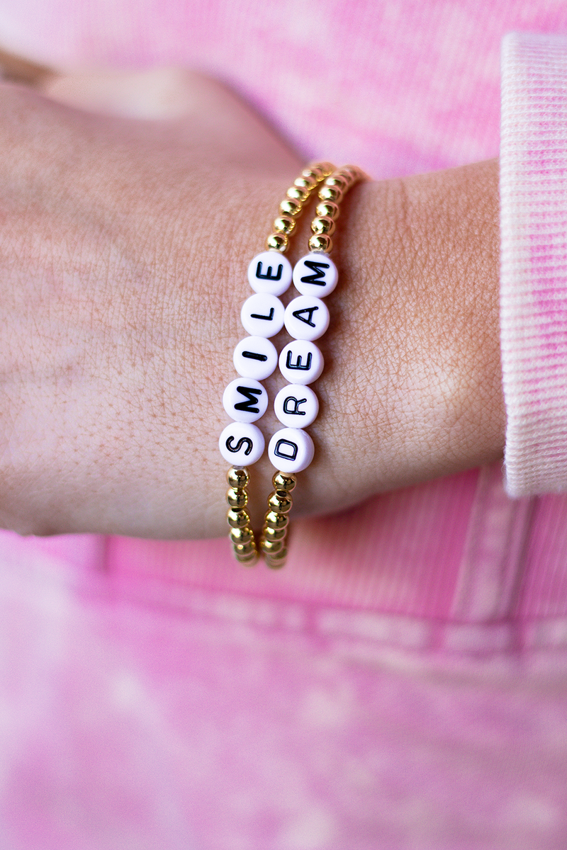 WE LOVE PIECES THAT GIVE US A LITTLE MOTIVATION! OUR NEWEST TINY WORD PIECES GIVE ANY OUTFIT A LITTLE MORE FUN!! COMES IN A PACK OF 2!   - You receive both pieces