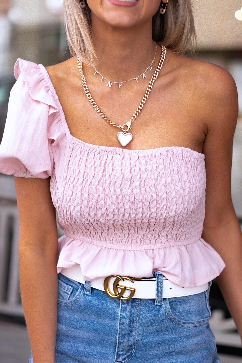 THE NEED FOR MORE TOPS IS ALWAYS HIGH. THIS SWEET BLUSH ONE SHOULDERED TOP IS GREAT FOR SPRING.  -Taylor is wearing a size Taylor -color: matte blush -one shouldered puff sleeve -crop top -accordion stitching and stretch