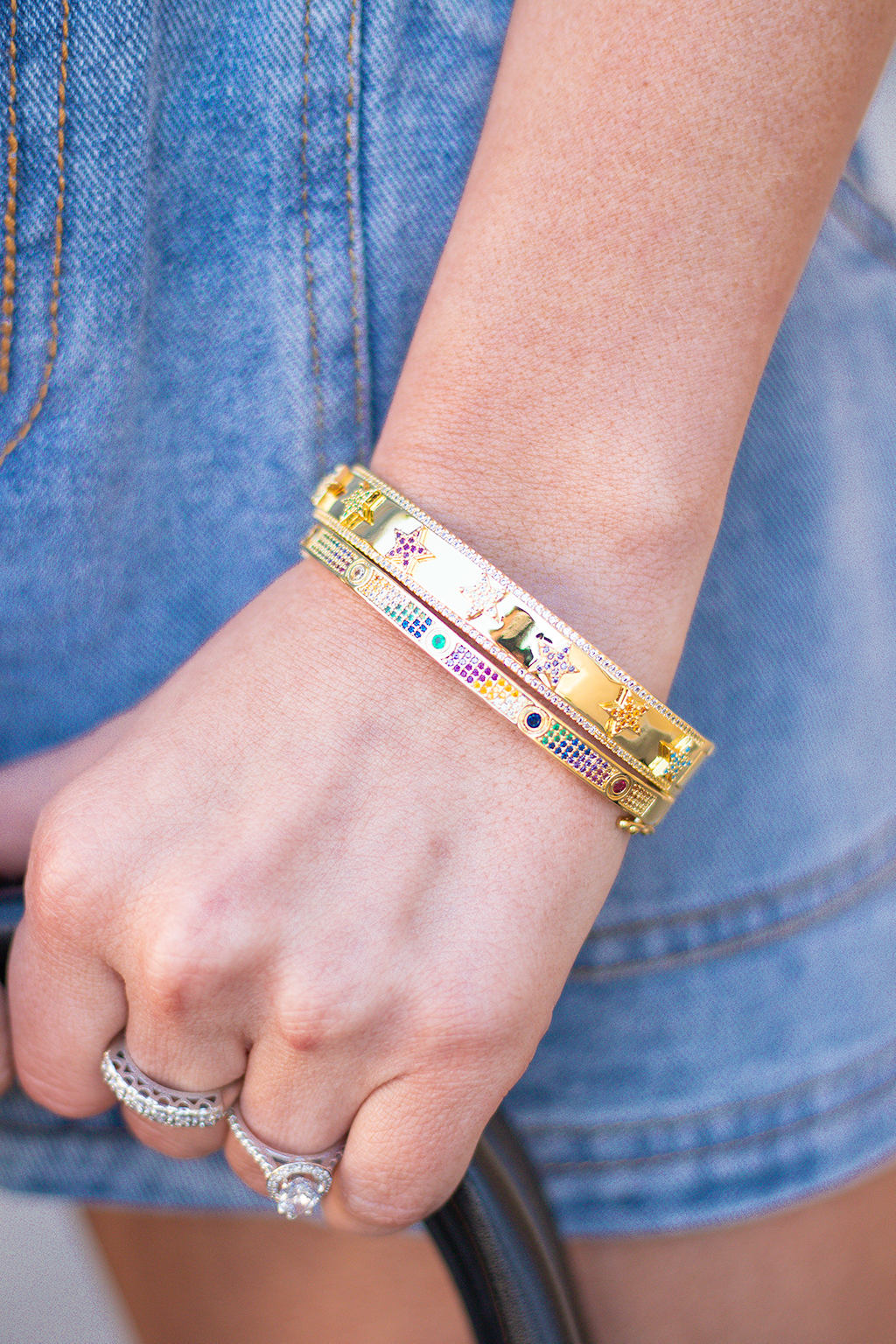 If youre looking for a fun Cartier dupe than you have found the perfect one!! Our newest Gemili bravely features little colorful rainbow jewels with the iconic set up of the LOVE bracelets from Cartier!!